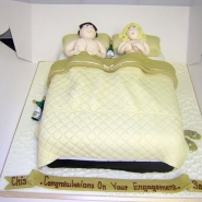 couple_in_bed_cake